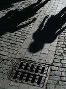 Shadows of people on street Stock Photos