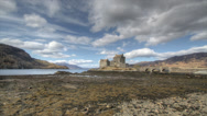 Stock Video Footage of Timelapse of the famous Eilean Donan Castle in the Scottish Highlands.