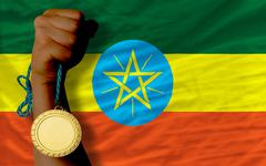 Gold medal for sport and  national flag of ethiopia Stock Photos