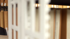 4K View Along Rows of Shelves of Man Reading in Library CU Stock Footage
