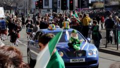 Birmingham's St Patrick's Day parade 2014 - leprechaun and bagpipers Stock Footage