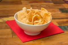 traditional chinese prawn crackers in white bowl - stock photo