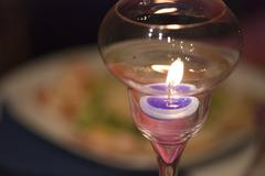 Lighted Candle over a Table Stock Photos