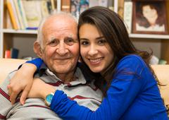 Grandfather and granddaughter Stock Photos