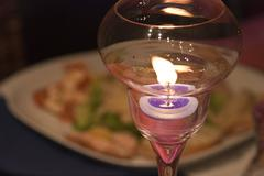 Lighted Candle over a Table - stock photo