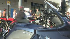 Blured motorbikes passing parked bikes bmw slow shutter speed Stock Footage