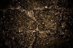 Damaged cracked asphalt pattern texture Stock Photos