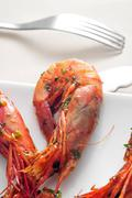 Spanish shrimps with garlic and parsley Stock Photos