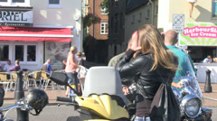 Motorbikes- biker girl ties hair back no face Stock Footage