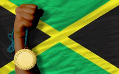 gold medal for sport and  national flag of jamaica - stock photo