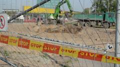 Stop line bar excavator dig dirt truck construction site Stock Footage
