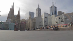 Slow wide angle pan of federation square Stock Footage