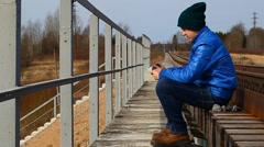 Teenage on the railway bridge Stock Footage