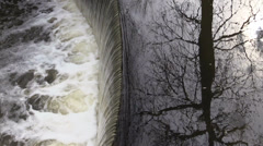 Waterfall on the river and the reflection of the Tree Stock Footage