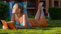 Relaxation with reading on resort Stock Footage