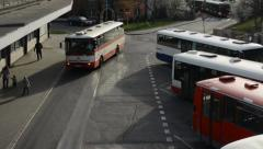 PRAGUE, CZECH REPUBLIC: Bus depot and people leave the bus Stock Footage