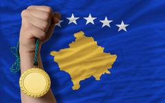 gold medal for sport and  national flag of  of kosovo - stock photo
