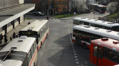PRAGUE, CZECH REPUBLIC: Bus depot and people leave the bus - stock footage