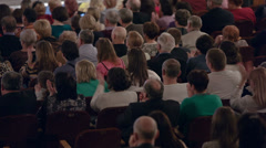 Audience applauding and watching show - stock footage