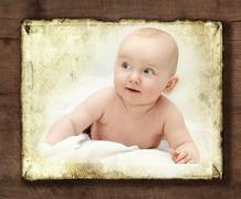 Baby looking aside smiling Stock Photos