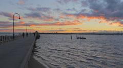 pan of  ocean sunset at st kilda beach pier - stock footage