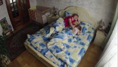 Grandmother bedding granddaughter in the bedroom to sleep. Timelapse. Stock Footage