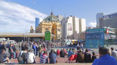 Wide shot of people watching a performance at federation square -  sunny day Stock Footage
