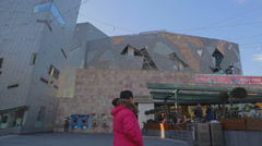 Pan of SBS building at federation square and melbourne skyline Stock Footage