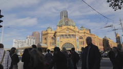 Flinders street station seen in the sunlight - pan to flinders street Stock Footage