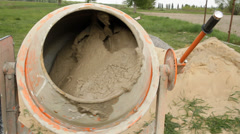 Electricall concrete mixer at work - stock footage