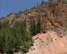 KOOTENAY NATIONAL PARK  The Redwall Fault - pan towering iron-rich cliffs Stock Footage