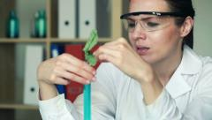 Unhappy biochemist looking at dead plant in test tube HD Stock Footage