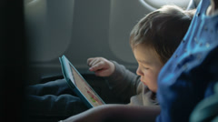 Little boy traveling in an airplane - stock footage