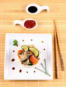 chicken meat in china pan asian rice with vegetables - stock photo