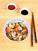chicken meat in china pan-asian noodle with vegetables - stock photo