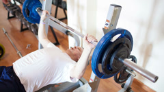 Exercising with weight lifting Stock Footage