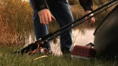 Canoe fishing tackle pick up Stock Footage