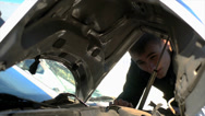 Stock Video Footage of Man looking under damage hood