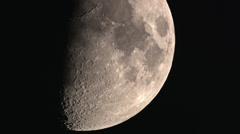 Half moon crossing showing off lower craters 4K Stock Footage