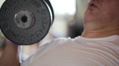 Man lifting dumb-bells Stock Footage