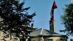 Halifax Nova Scotia New Scotland Canada 080 waving Canadian national flag Stock Footage