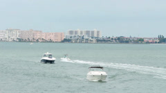 Boats sailing in towards camera in Tampa Bay, FL Stock Footage