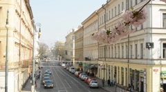 PRAGUE, CZECH REPUBLIC - APRIL 2014: flowering branch with busy street Stock Footage