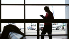 Using pad at the airport - stock footage
