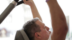 Exercising in the fitness center Stock Footage