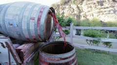 Shot of red wine falling from one barrel to the other Stock Footage