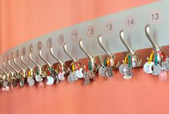 Coat hooks with keychains organized in a row Stock Photos