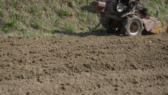 Cultivator plowing garden Stock Footage