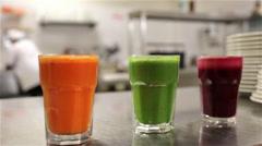 Three Glasses Of Freshly Squeezed Organic Vegetable Juice Stock Footage