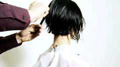 Professional hairstylist cutting hair with razor Stock Footage